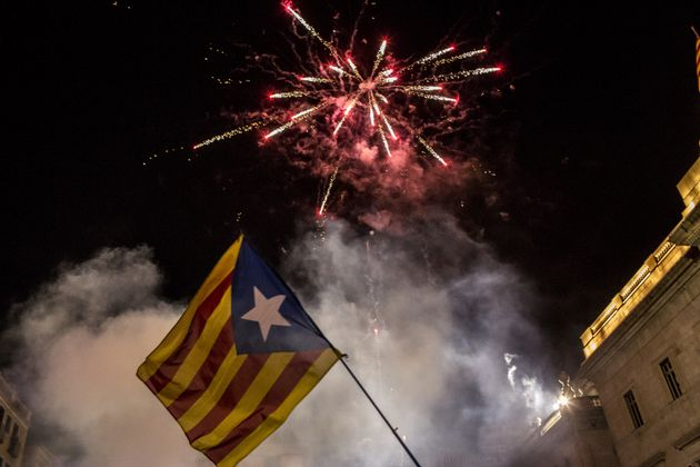 Fireworks illuminate the skay as pro-independence supporters gather at Sant Jaume