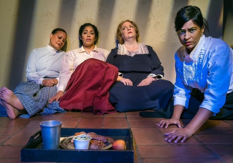 Nicol Foster, Regina Morones, Gwen Loeb, and Radhika Rao in the hunger strike scene from <strong><em>Strange Ladies</em></str