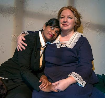 Vida (Radhika Rao) and Rose (Gwen Loeb) take a break from the picket line in a scene from <strong><em>Strange Ladies</em></st