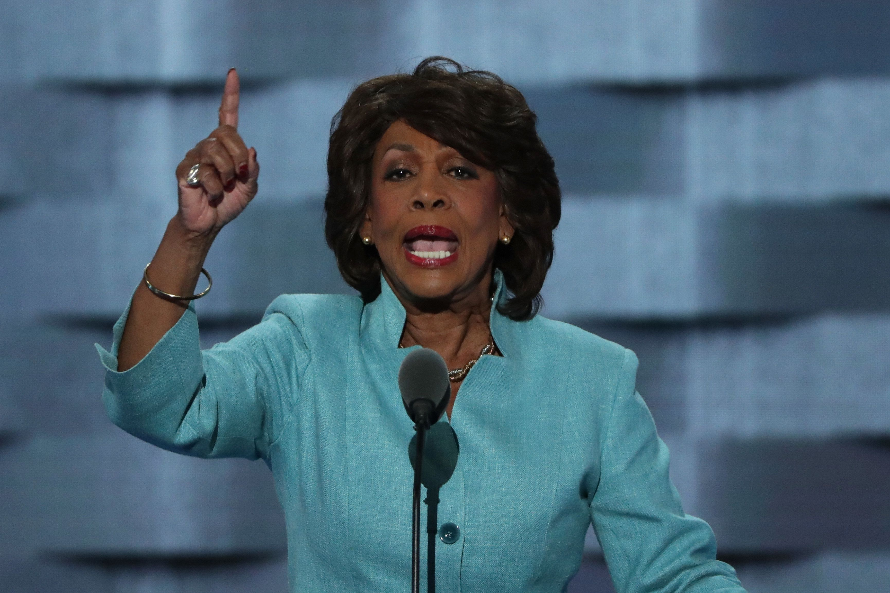 PHILADELPHIA, PA - JULY 27:  U.S. Representative Maxine Waters (D-CA) gestures as she delivers remarks on the third day of the Democratic National Convention at the Wells Fargo Center, July 27, 2016 in Philadelphia, Pennsylvania. Democratic presidential candidate Hillary Clinton received the number of votes needed to secure the party's nomination. An estimated 50,000 people are expected in Philadelphia, including hundreds of protesters and members of the media. The four-day Democratic National Convention kicked off July 25.  (Photo by Alex Wong/Getty Images)