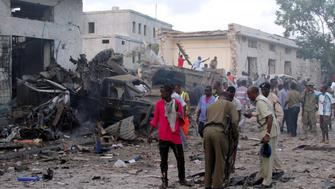 Somali security officers assess the damage at the scene of a suicide car bomb explosion, at the gate of Naso Hablod Two Hotel in Hamarweyne district of Mogadishu, Somalia October 28, 2017. REUTERS/Feisal Omar