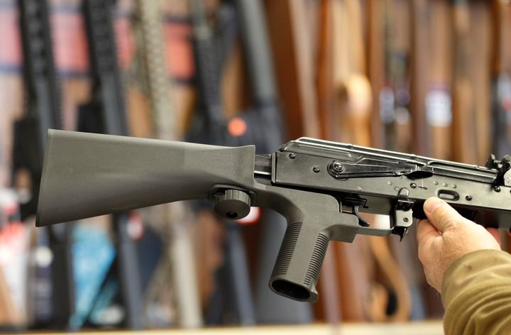 A bump stock device (left) fits on a semi-automatic rifle to increase the firing speed, making it similar to a fully automati