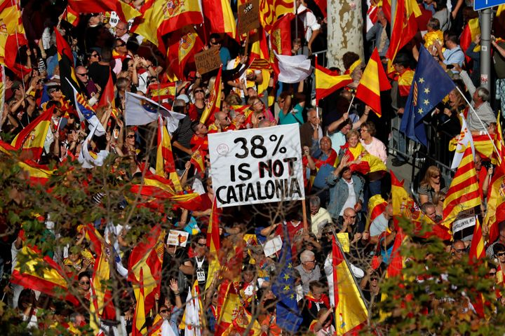 Pro-unity supporters take part in a demonstration in central Barcelona, Spain, October 29, 2017.