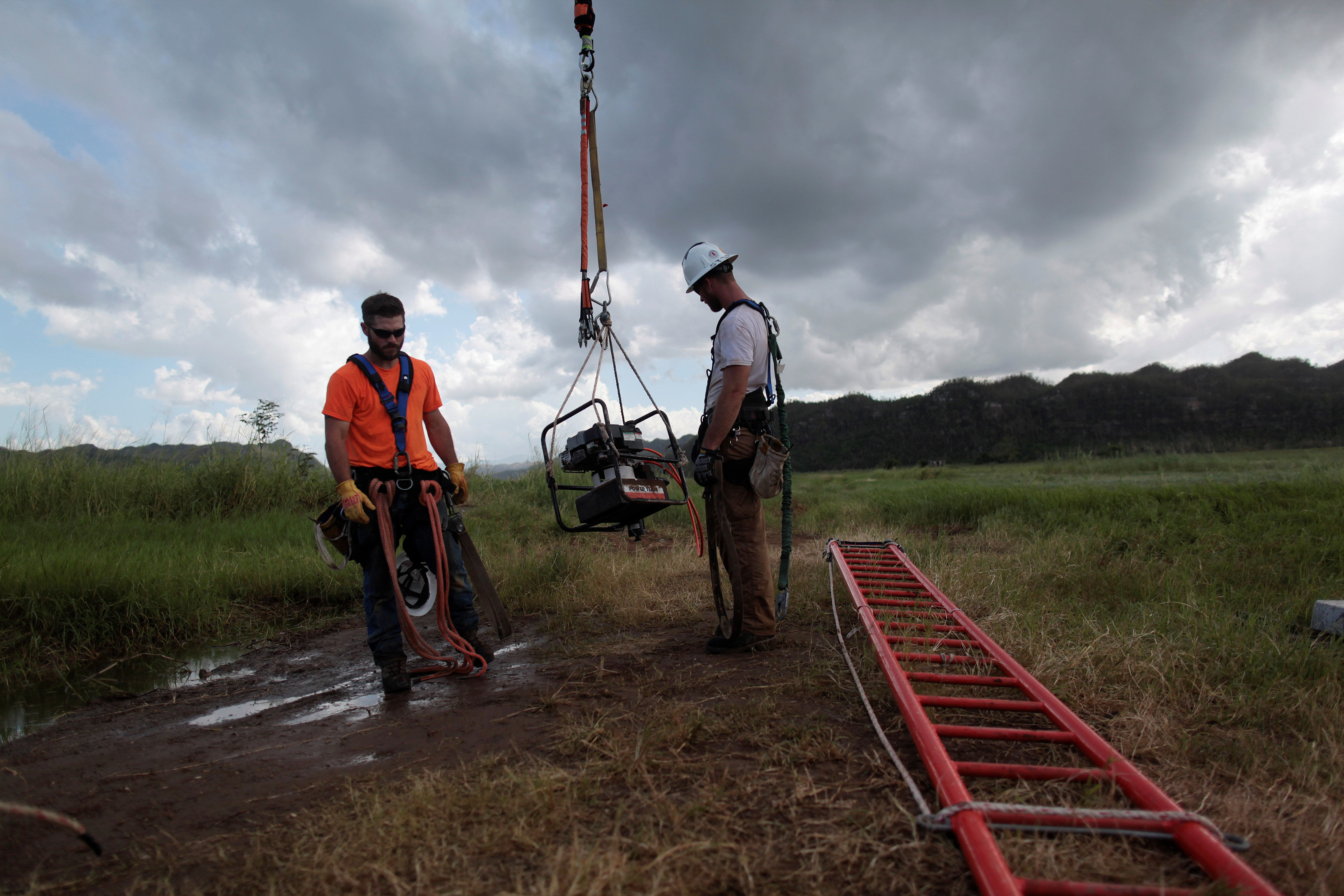 Workers from Montana-based Whitefish Energy Holdings help fix the island's power grid, damaged during Hurricane Maria in September, in Manati, Puerto Rico October 25, 2017.  REUTERS/Alvin Baez