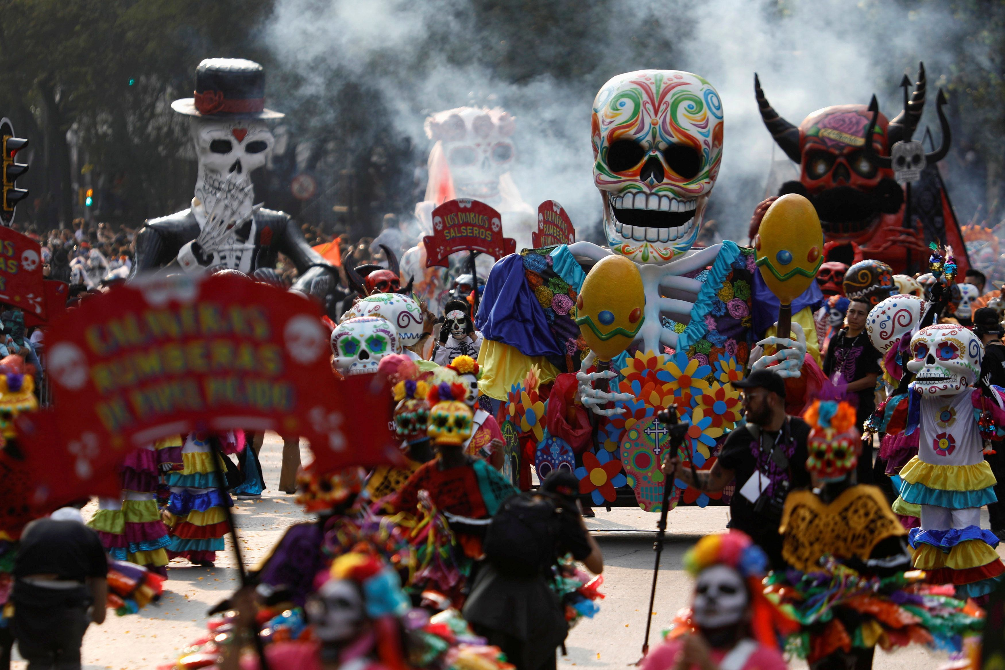 Skull figures are seen during a procession to commemorate Day of the Dead in Mexico City, Mexico, on Saturday.