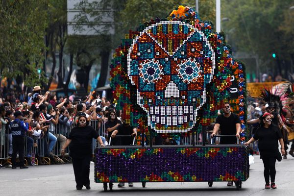 A float with a skull figure participates in a procession to commemorate Day of the Dead in Mexico City on Saturday.