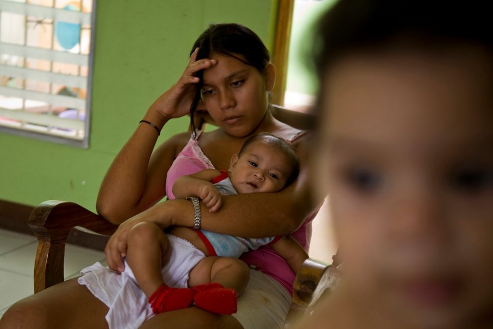 Marta, 16 at the time,ina refuge foryoung mothers. In Nicaragua, abortion is illegal even when girls become