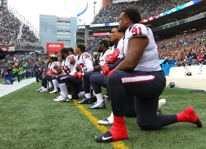 Texan team members kneel during anthem after owner insult
