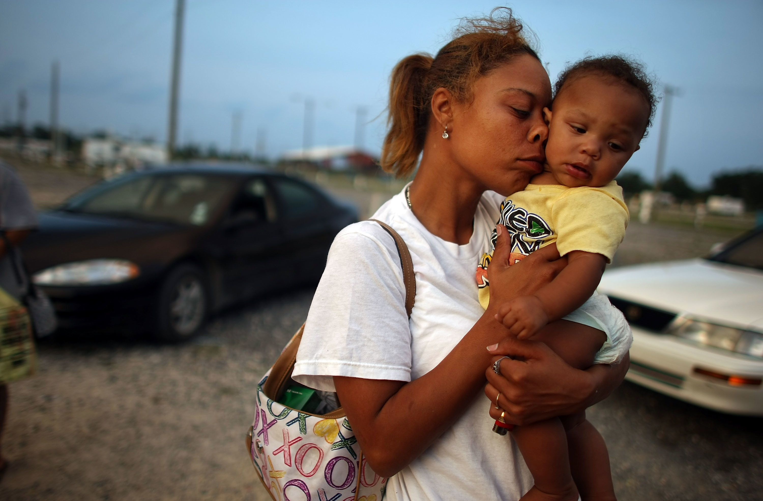 PORT SULPHUR, LA - MAY 26:  Shelly Phillips holds niece Kimmore Barthelemy in the FEMA Diamond travel trailer park May 26, 2008 in Port Sulphur, Louisiana. Phillips lost her home and job in Hurricane Katrina and is raising four children. FEMA federal trailer parks that house many Hurricane Katrina victims are set to close May 31, prompting fears that people will be forced into residences they can't afford or will be left homeless. Most residents will receive a federal subsidy to move to apartments, but affordable rental housing is scarce in some areas like New Orleans and Baton Rouge.  (Photo by Mario Tama/Getty Images)
