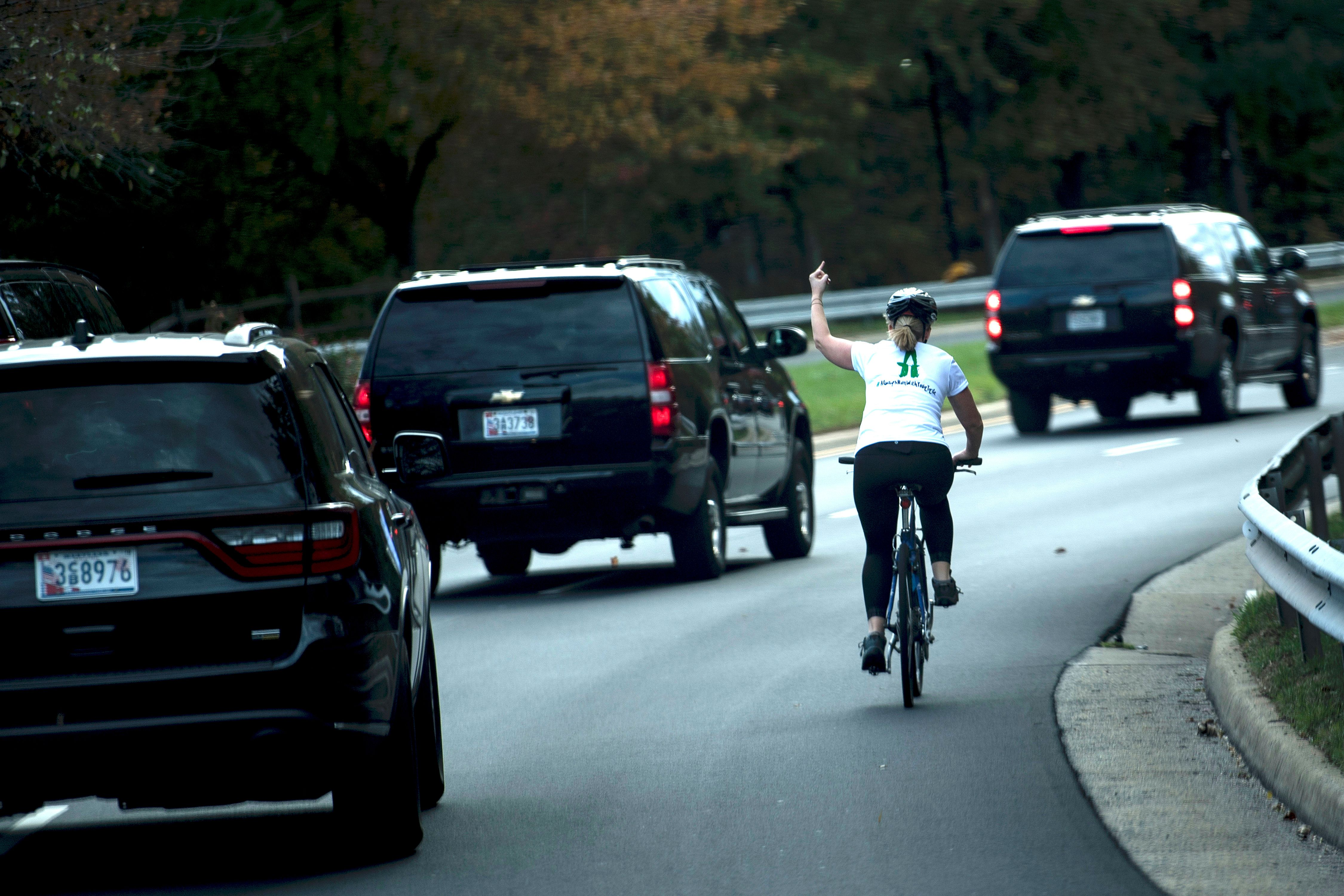 A female cyclist lets the White House know how she feels about the Trump administration as the president's motorcad
