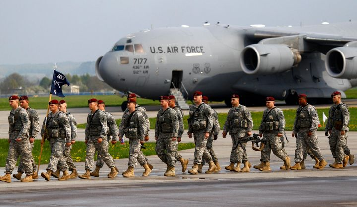 About 150 U.S. paratroopers from the U.S. Army's 173rd Infantry Brigade Combat Team based in Italy march as they arrive to pa