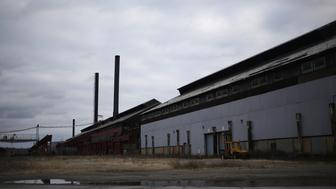 The remnants of buildings stand on the grounds of the former U.S. Steel McDonald Works steel mill near Youngstown in Campbell, Ohio, U.S., on Tuesday, Dec. 1, 2016. The conventional wisdom among election observers and establishment politicians is that widespread anger at being left behind by globalization compelled Britons to forsake the European Union and Americans to vote for Donald Trump. Photographer: Luke Sharrett/Bloomberg via Getty Images