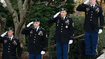 ARLINGTON, VA - NOVEMBER 17: Members of the U.S. Army Special Forces salute during a wreath-laying ceremony at President John F. Kennedy's gravesite at Arlington Cemetery, on November 17, 2011 in Arlington, Virginia.  In 1961 President Kennedy authorized U.S. Army Special Forces to wear the Green Beret. Today's ceremony was held to honor Kennedy's vision to build a dedicated counterinsurgency force 50 years ago.  (Photo by Mark Wilson/Getty Images)
