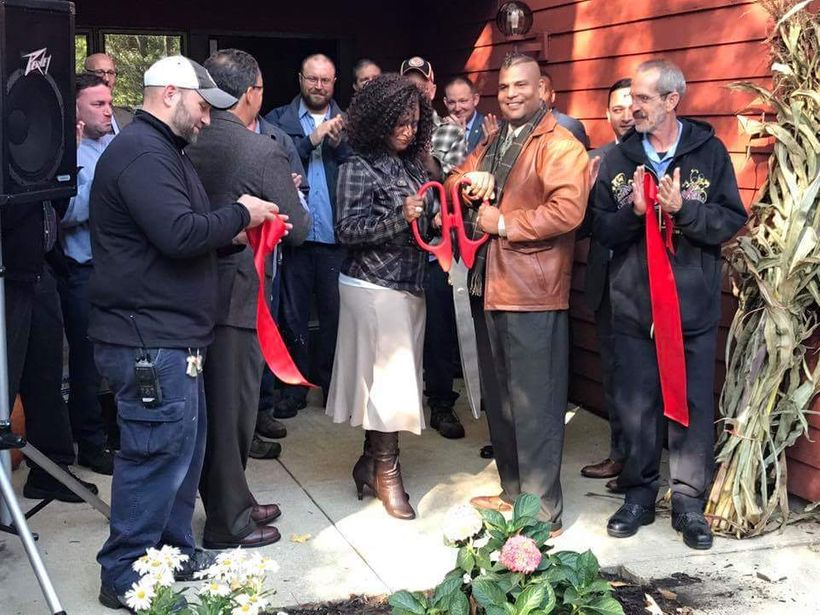 BMe Genius Denny Wilson and wife Kara Wilson cut the ribbon at their new recovery center.
