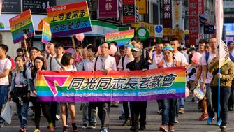 TAIPEI, TAIWAN - 2017/10/28: Group from a Presbyterian Church march at the Taipei 2017 LGBT Pride Parade in support for same sex union and marriage. Many Christian groups in Taiwan  are against same sex marriage rights but the Presbyterian church has always been a strong supporters for the LGBT rights. The parade has attracted over 100,000 people in a country where same sex marriage was legalized but that has not yet been made into a law. (Photo by Alberto Buzzola/LightRocket via Getty Images)