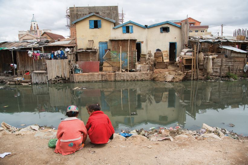 Untreated sewage mixes with runoff water in the Antohomadinika community of Antananarivo and flows within meters of housing r
