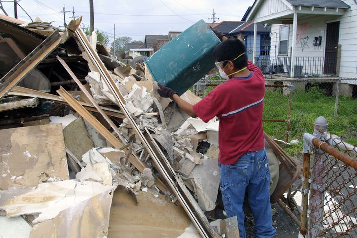 New Orleans, Louisiana, USA - March 20, 2006: A university student on Spring Break helps gut an abandoned house in the Lower