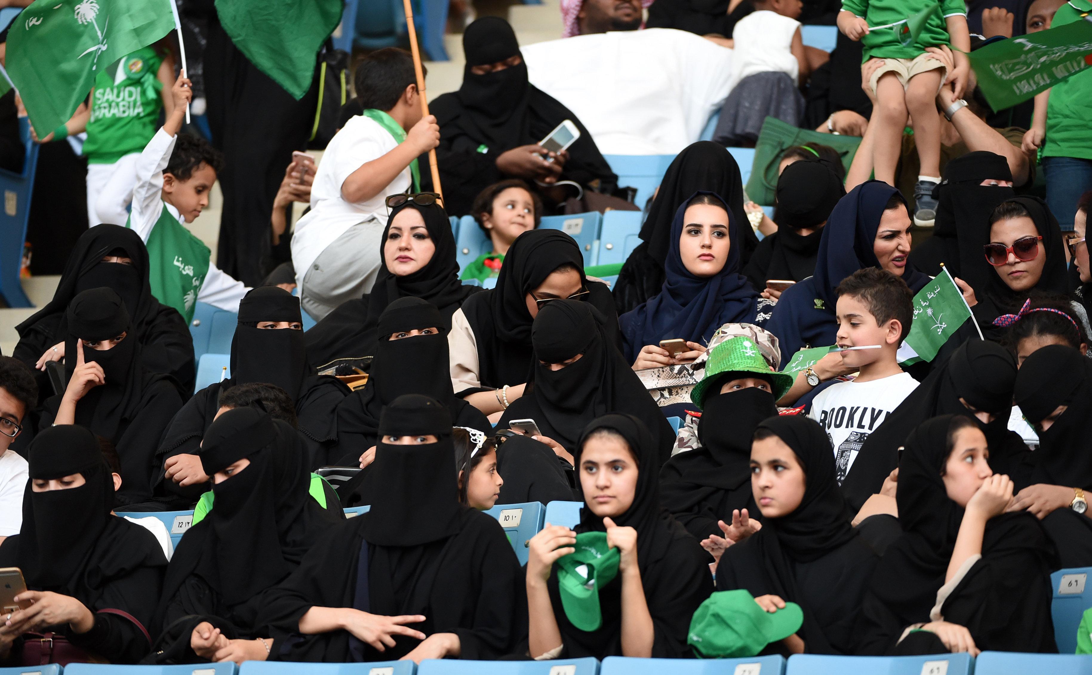 Womencommemorate the anniversary of Saudi Arabia's founding atKing Fahd International Stadium in Riyadh on Sept.