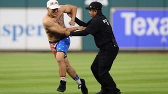 HOUSTON, TX - OCTOBER 29:  Security apprehends a fan running on the field during game five of the 2017 World Series between the Houston Astros and the Los Angeles Dodgers at Minute Maid Park on October 29, 2017 in Houston, Texas.  (Photo by Christian Petersen/Getty Images)