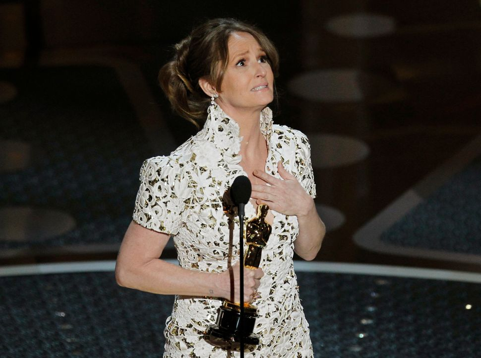 "Melissa Leo accepts her Oscar for ""The Fighter"" on Feb. 27, 2011."