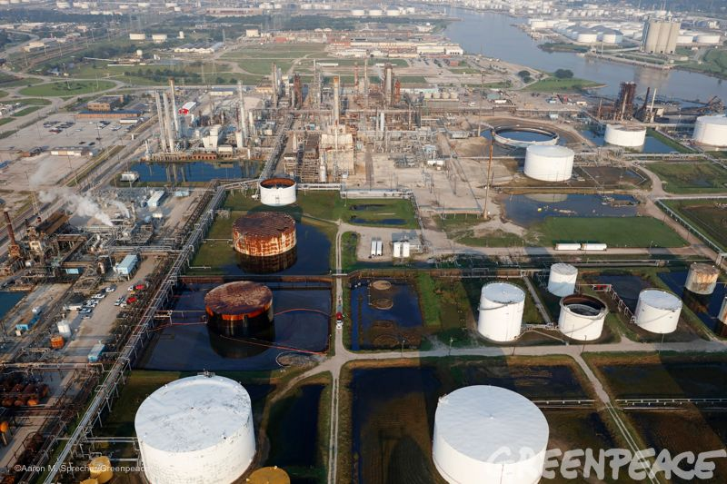 A crew tries to contain oil from a damaged oil refinery storage tank in La Porte, Texas more than a week after Hurricane Harv