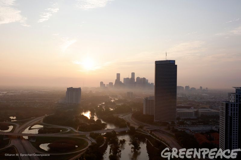Water still runs at a high level through the Buffalo Bayou in downtown Houston as the sun rises more than a week after Hurric