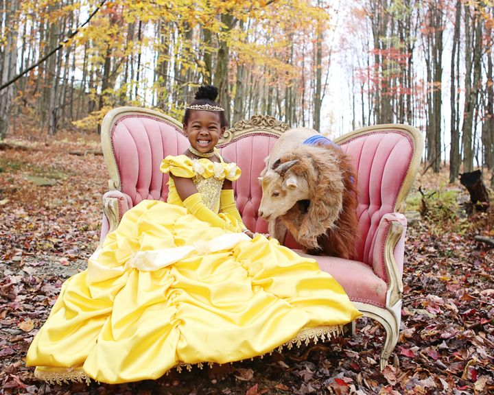 Lindsey Bonnice's kids and pets wear coordinated Halloween costumes.