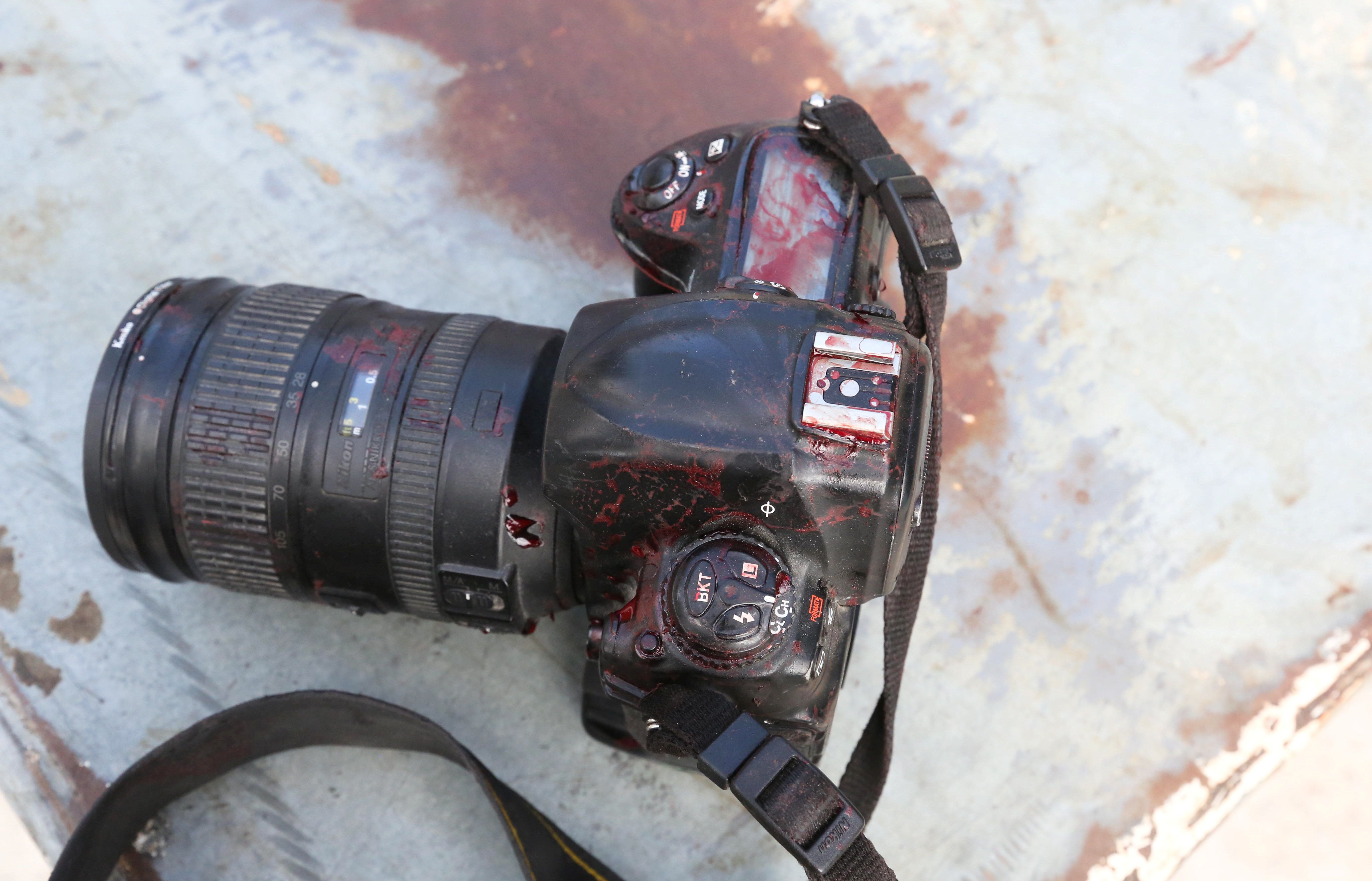 The blood stained camera of a photojournalist is seen in front of Dayah hotel in Somalia's capital Mogadishu,...