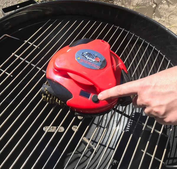 """This <a href=""""https://grillbots.com/"""" target=""""_blank"""">grill-cleaning robot</a>scours all the gunk off a grill and makes"""
