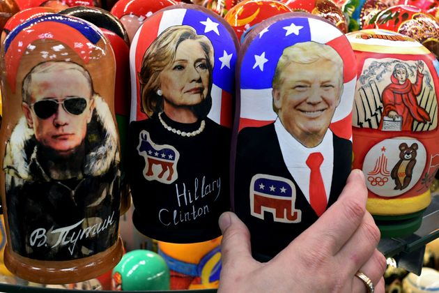 Traditional Russian wooden nesting dolls depicting Russia's President Vladimir Putin, US Democratic presidential...
