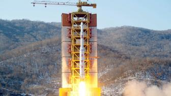 A North Korean long-range rocket is launched into the air at the Sohae rocket launch site, North Korea, in this photo released by Kyodo February 7, 2016. North Korea launched a long-range rocket on Sunday carrying what it has called a satellite, but its neighbours and Washington denounced the launch as a missile test, conducted in defiance of U.N. sanctions and just weeks after a nuclear bomb test.  Mandatory credit REUTERS/Kyodo    ATTENTION EDITORS - THIS IMAGE HAS BEEN SUPPLIED BY A THIRD PARTY. FOR EDITORIAL USE ONLY. NOT FOR SALE FOR MARKETING OR ADVERTISING CAMPAIGNS. MANDATORY CREDIT. JAPAN OUT. NO COMMERCIAL OR EDITORIAL SALES IN JAPAN. THIS PICTURE IS DISTRIBUTED EXACTLY AS RECEIVED BY REUTERS, AS A SERVICE TO CLIENTS.