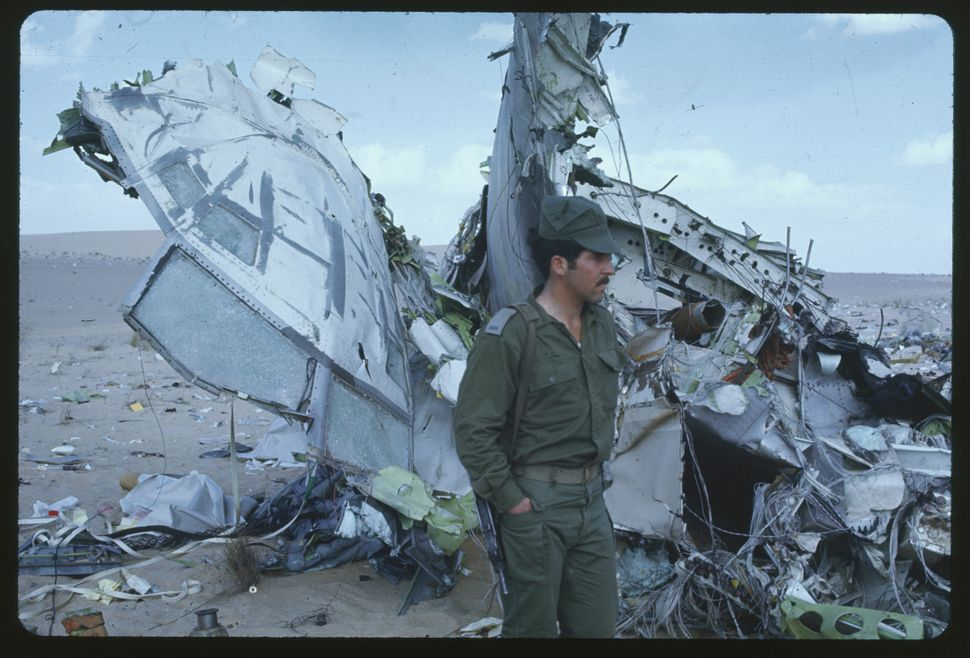 An Israeli soldier stands guard over the charred wreckage of the Libyan Airlines 727 here. The plane was downed by Isreali je