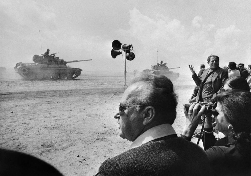 Israeli Prime Minister Yitzhak Rabin, attends an army parade at Mitla Pass in the Sinai of Egypt on March 3, 1975. The event