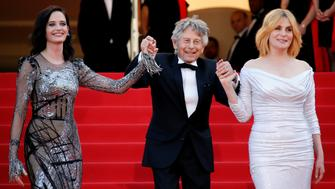 "70th Cannes Film Festival - Screening of the film ""Based on a True Story"" (D'apres une histoire vraie) out of competition - Red Carpet Arrivals - Cannes, France. 27/05/2017. Director Roman Polanski and cast members Eva Green, Emmanuelle Seigner pose. REUTERS/Jean-Paul Pelissier"