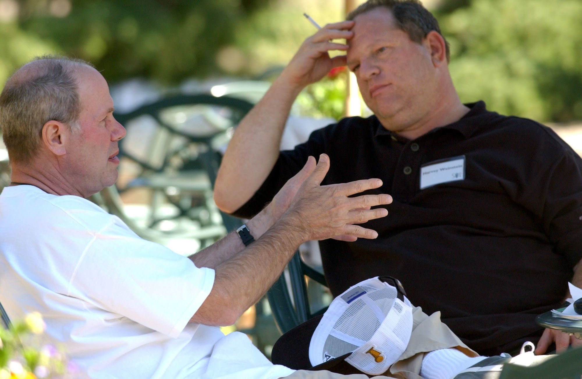 UNITED STATES - JULY 08:  Walt Disney Co. CEO Michael D. Eisner, left, talks with Miramax Film Corp. Co-Chairman Harvey Weinstein on the grounds of the Sun Vally resort during the Allen & CO conference in Sun Valley, Idaho, Thursday, July 8, 2004.  (Photo by Matthew Staver/Bloomberg via Getty Images)