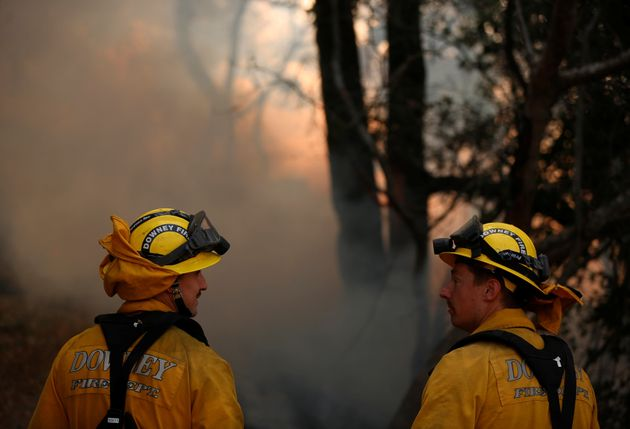 Firefighters work to control a wildfire in Sonoma County on Oct. 14,