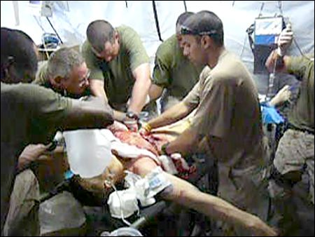 Dr. Sudip Bose and his team work on an injured soldier in Iraq.