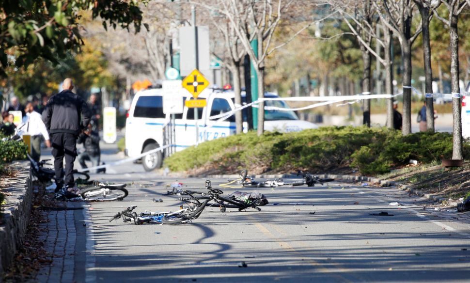 Multiple bikes crushed along a bike path in lower Manhattan.