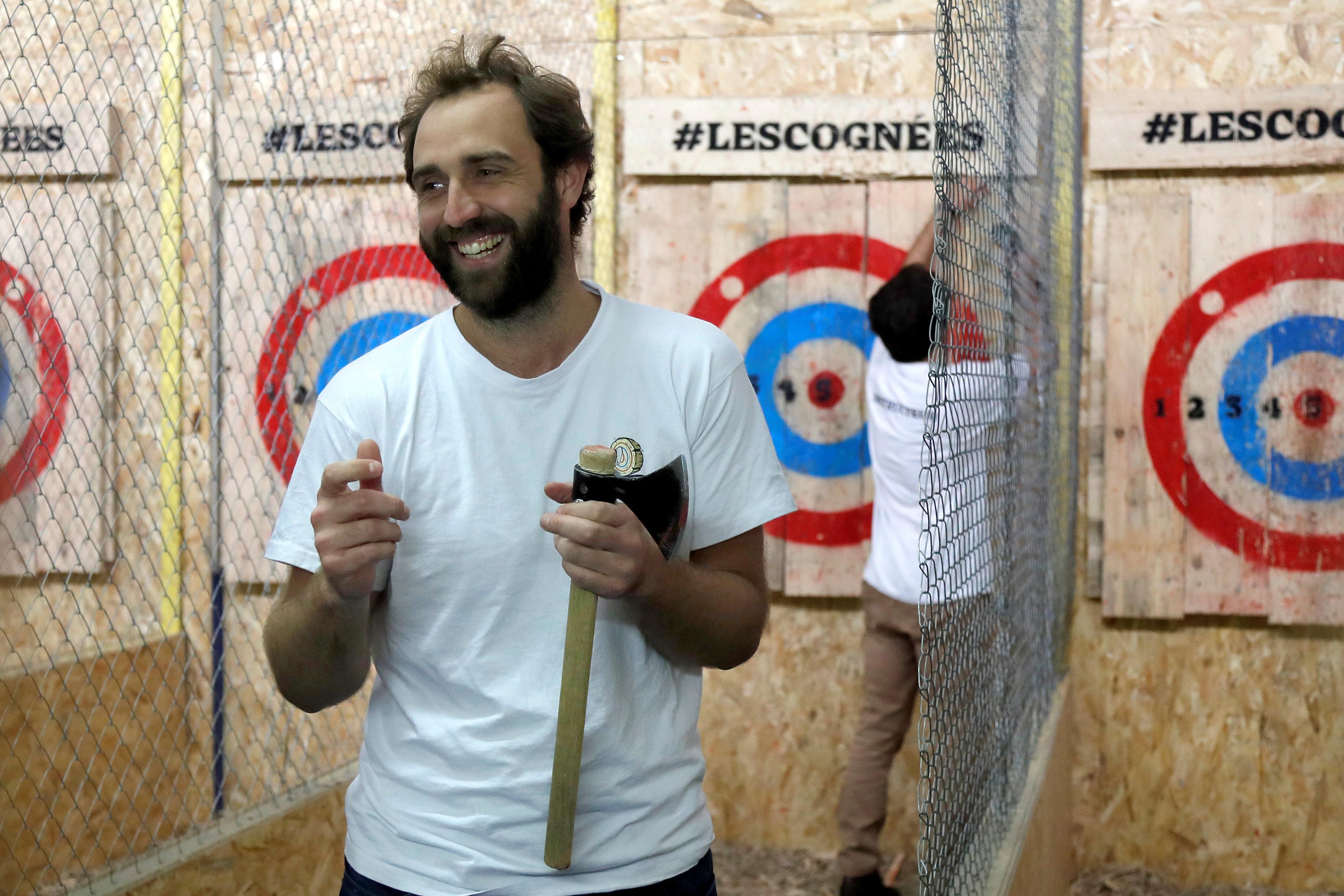 """Thomas Morel, founder ofParis' new axe-throwing venue """"Les Cognees."""""""