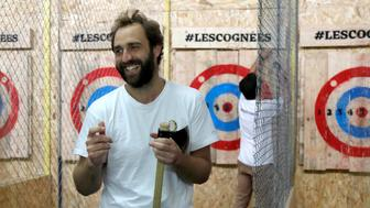 """Thomas Morel, founder of the new opened axe-throwing venue """"Les Cognees"""" (Axes) talks to participants in Paris, France, October 26, 2017. Picture taken October 26, 2017.   REUTERS/Charles Platiau"""