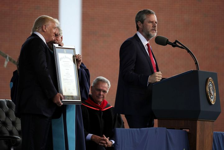 Jerry Falwell Jr. speaks as President Trump is presented with a Doctorate of Laws  during a commencement at Liberty Univ