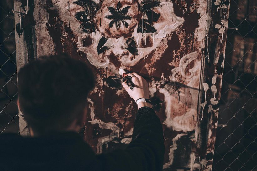 Artist painting Gypsy-inspired installation for Lumiér Garson by Jean Rudoff at the Museum of Moscow