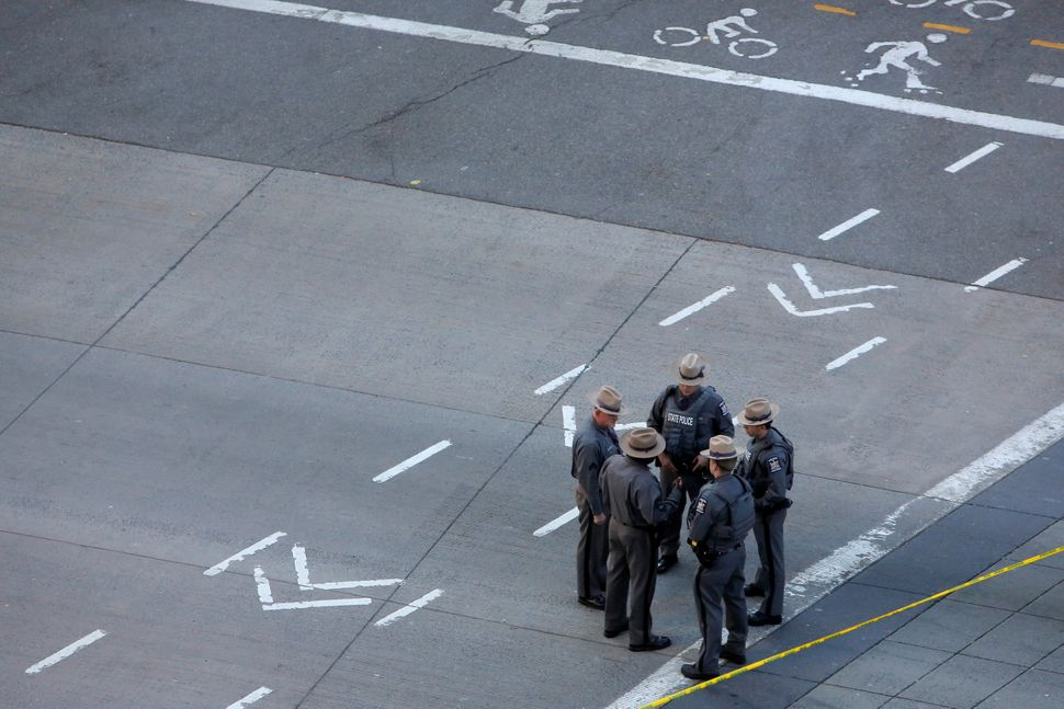 State Police stand near the scene of a pickup truck attack, on West Street in Manhattan, New York, U.S., October 31 2017.  RE