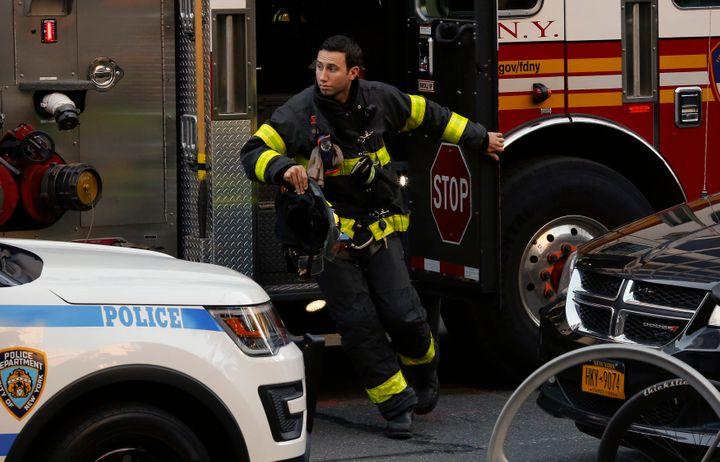 Emergencymedical technicians rush to help victims in lower Manhattan.