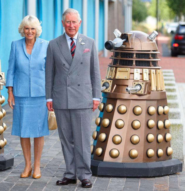 A Dalek, with Prince Charles and the Duchess of