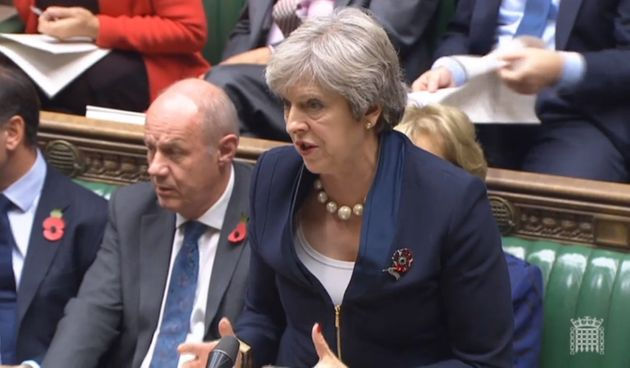 First Secretary of State Damian Green listens as Prime Minister Theresa May speaks during Prime Minister's...
