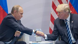 HAMBURG, GERMANY - JULY 07: Russian President Vladimir Putin (left) and President of the United States of America Donald Trump (right) shake hands during the meeting at G20 Summit on July 7, 2017 in Hamburg, Germany. (Photo by Dmitry Azarov/Kommersant via Getty Images)