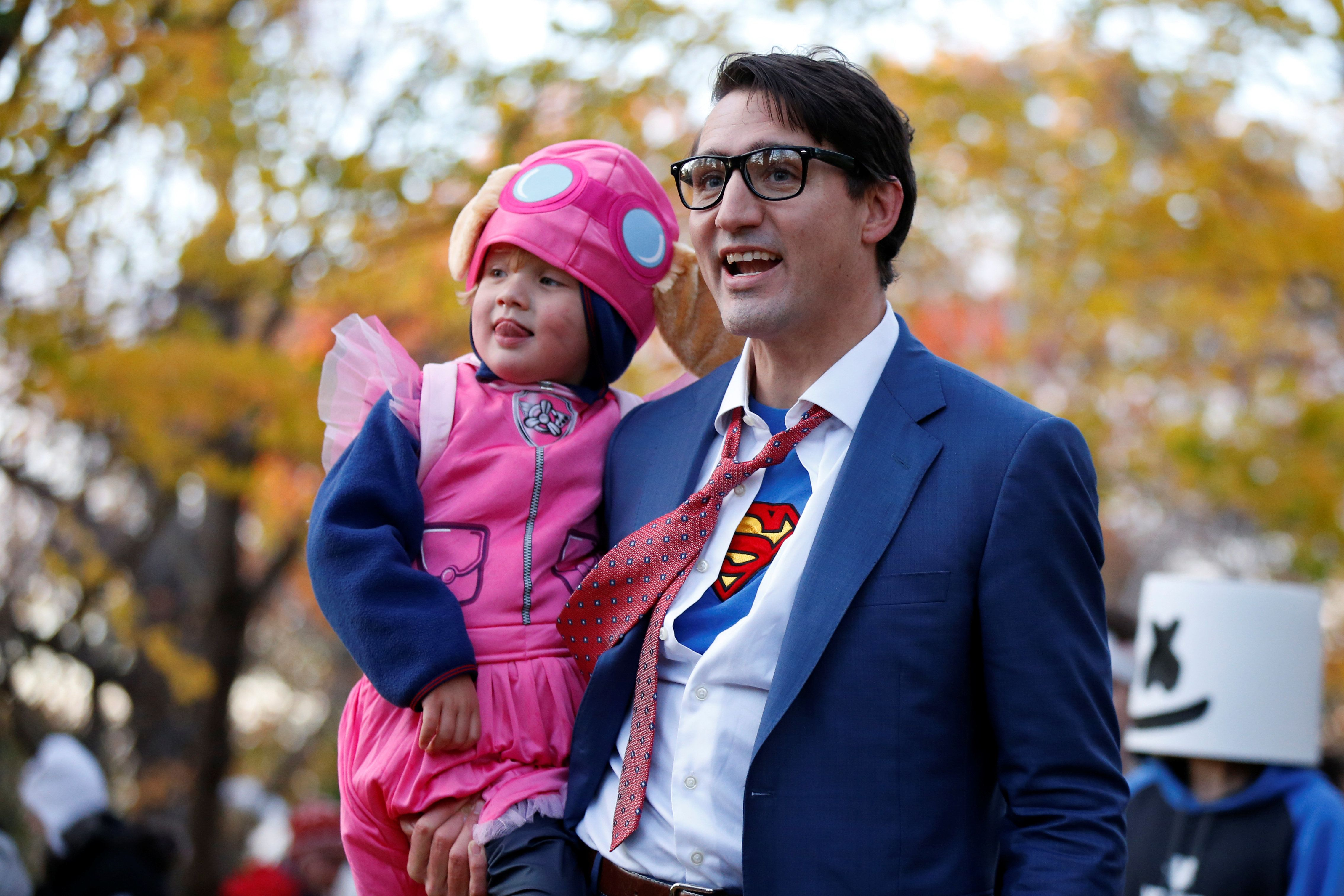 Justin Trudeau carries his son Hadrien while participating in Halloween festivities at Rideau Hall in Ottawa, Ontario, Canada