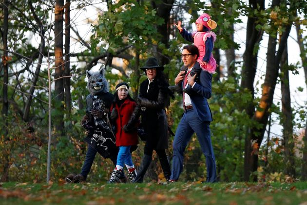 Justin Trudeau walks with his wife, Sophie, and their children as they arrive for Halloween festivities...