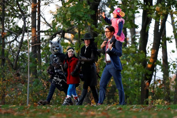 Justin Trudeau walks with his wife, Sophie, and their children as they arrive for Halloween festivities at Rideau Hall.